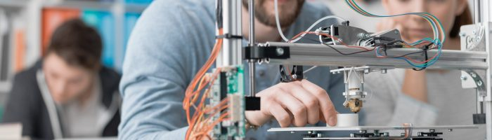 Students using a 3D printer
